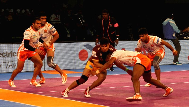 Players in action during a Pro Kabaddi League 2017 match between Puneri Paltan and U.P. Yoddha in Chennai, on Sept 30, 2017.