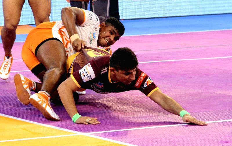 Players in action during a Pro Kabaddi League 2017 match betweenPuneri Paltan and U.P. Yoddha in Chennai, on Sept 30, 2017.
