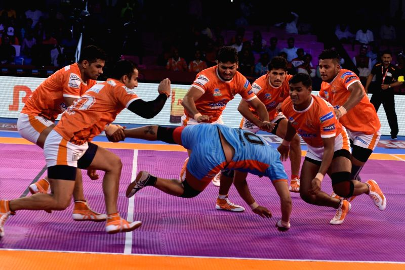 Players in action during a Pro Kabaddi League match between Puneri Paltan and Gujarat Bengal Warriors in Jaipur on Oct 6, 2017.