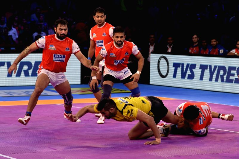 Players in action during a Pro Kabaddi League match between Haryana Steelers and Telugu Titans in Jaipur on Oct 7, 2017.