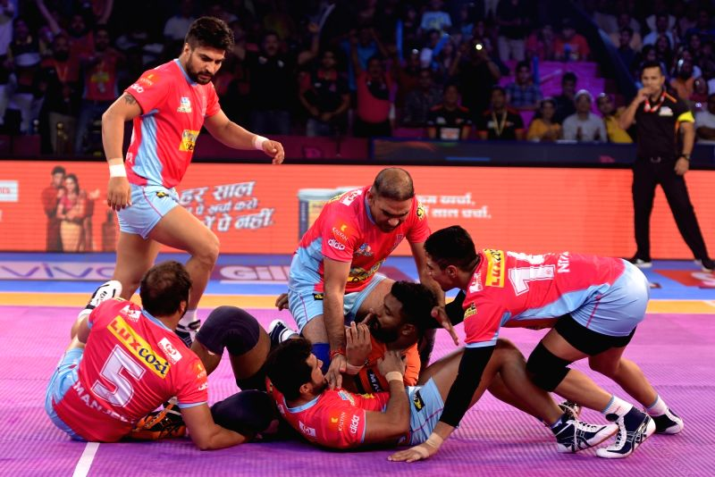 Players in action during a Pro Kabaddi League match between Jaipur Pink Panthers and U Mumba in Jaipur on Oct 7, 2017.