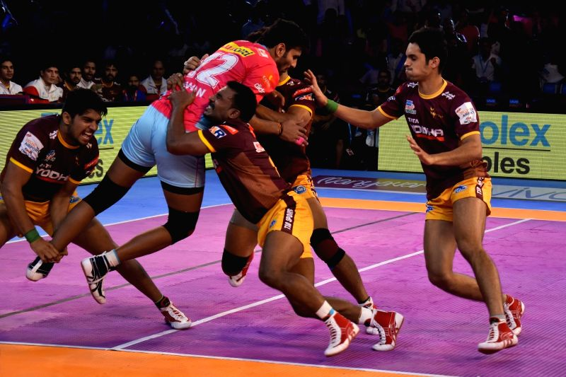 Players in action during a Pro Kabaddi League match between Jaipur Pink Panthers and U.P. Yoddha in Jaipur on Oct 12, 2017.