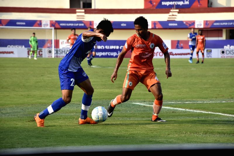 Players in action during a Super Cup Semi-final match between Bengaluru FC and Neroca FC in Bhubaneswar on April 13, 2018.