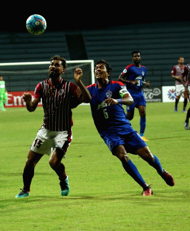 Players in action during an AFC Cup match between Mohun Bagan and JSW Bengaluru FC in Kolkata on May 17, 2017.