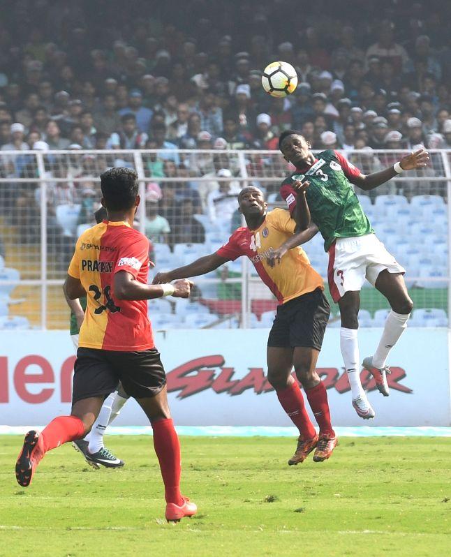 Players in action during an I-League match between Mohun Bagan A.C. and East Bengal F.C. at Vivekananda Yuba Bharati Krirangan in Kolkata on Jan 21, 2018. Under-pressure Mohun Bagan defied ...