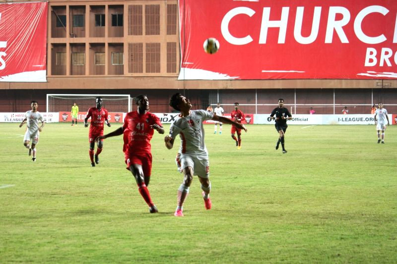 Players in action during an I-League match between Neroca FC and Churchill Brothers FC Goa at the Tilak Maidan in Vasco, Goa on Jan 30, 2018.