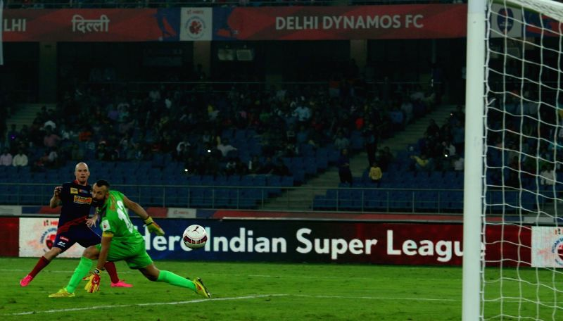 Players in action during an ISL match between Delhi Dynamos Football Club and Atletico de Kolkata in New Delhi on Nov 14, 2015.