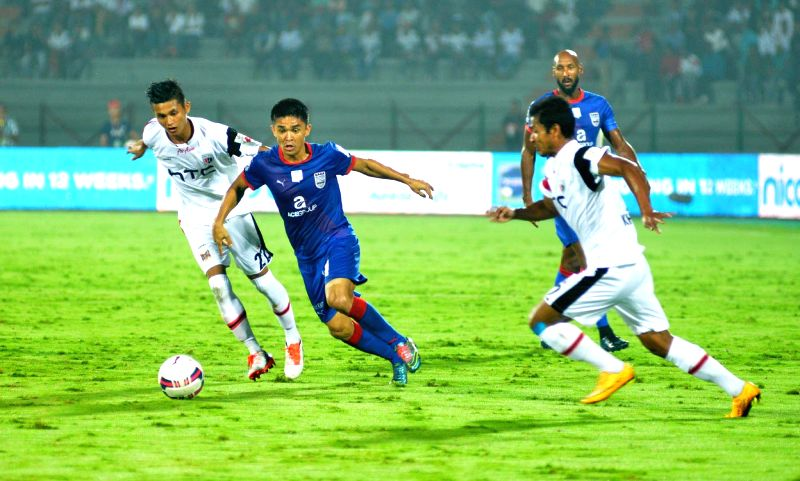 Players in action during an ISL match between North-East United FC and Mumbai City FC  in Guwahati, on Nov 20, 2015.