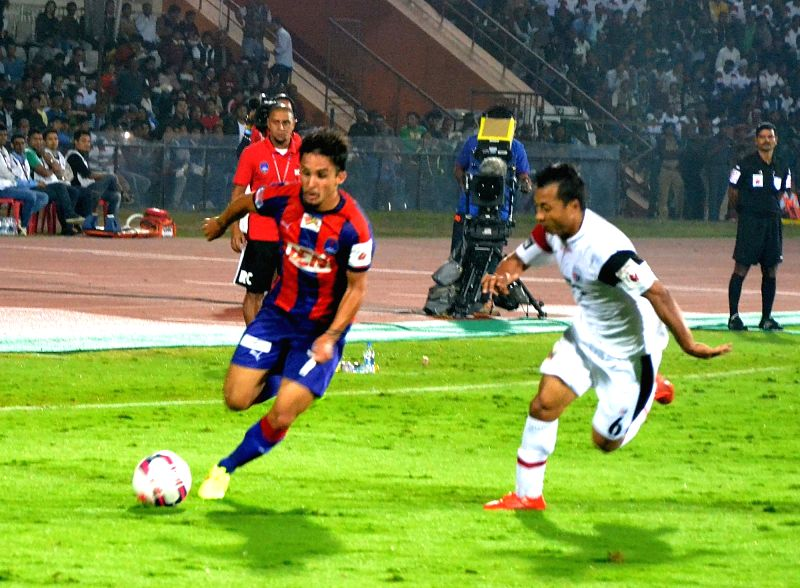 Players in action during an ISL match between Delhi Dynamos FC and NorthEast United FC at  Indira Gandhi Athletic Stadium  in Guwahati on Nov 28, 2015.