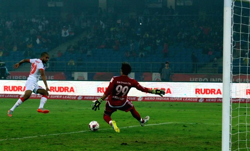 Players in action during an ISL match between Delhi Dynamos FC  and Mumbai City FC in New Delhi, on Dec 6, 2015.
