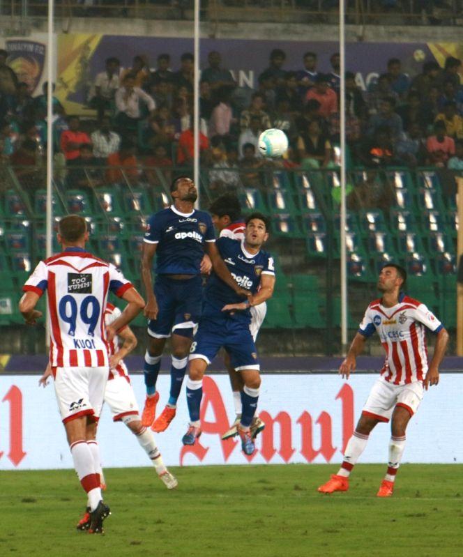 Players in action during an ISL match between Chennaiyin FC and Atletico de Kolkata FC at Jawaharlal Nehru Stadium in Chennai on Dec 7, 2017.