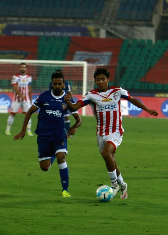 Players in action during an ISL match between Chennaiyin FC and Atletico de Kolkata FC at Jawaharlal Nehru Stadium in Chennai on Dec 7, 2017.