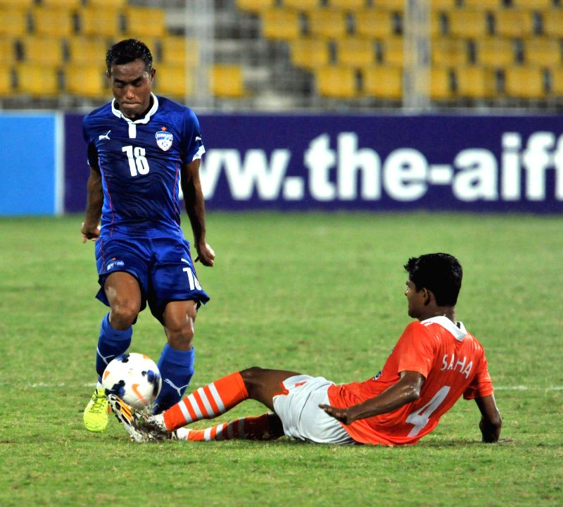 Players in action during Federation Cup semifinal match between Bengaluru FC and Sporting Clube de Goa in Margao, Goa on Jan 9, 2015.