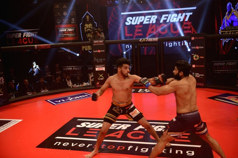 Players in action during the Super Fight League (SFL) between Bengaluru Tigers and Sher-e-Punjab in New Delhi on Feb 17, 2017.