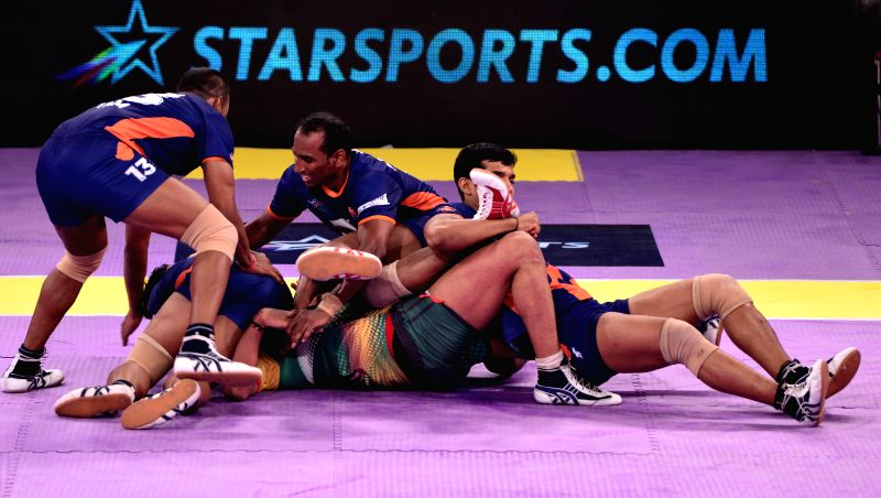 Players of Bengal Warriors and Patna Pirates in action during a Pro Kabaddi League match at Sawai Mansingh Indoor Stadium in Jaipur on Aug 21, 2014.