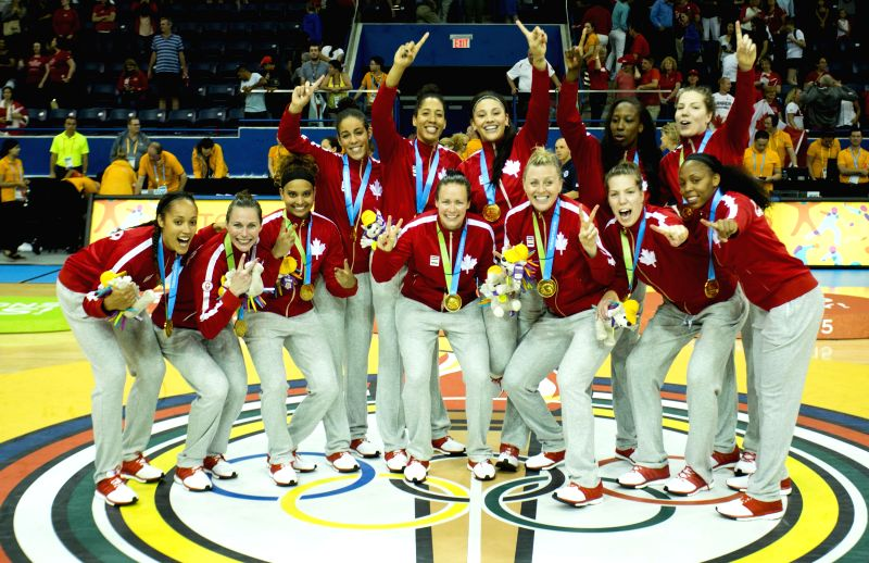 Players of Canada pose for photos during the victory ceremony of the women's final match of the basketball event at the 17th Pan American Games in Toronto, Canada, ...