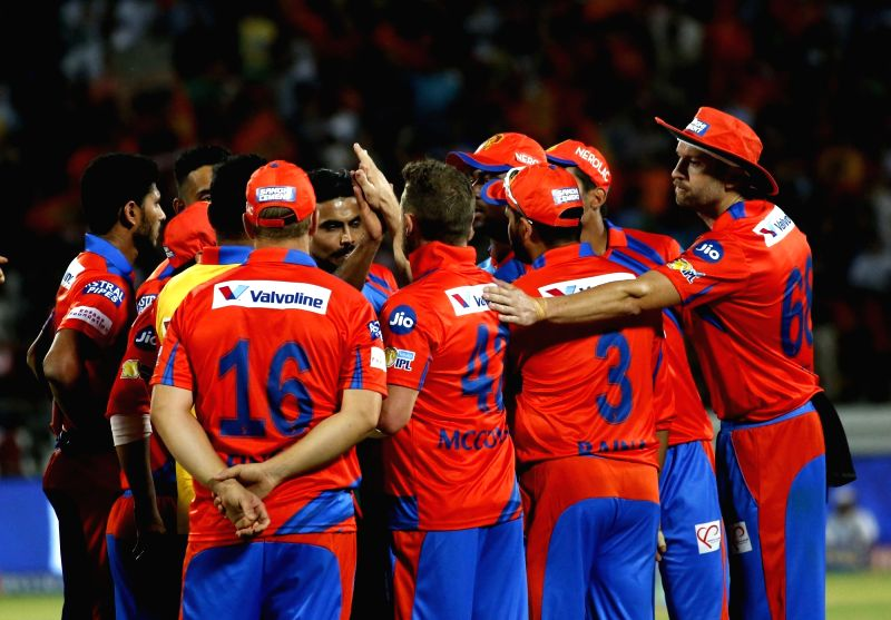 Players of Gujarat Lions celebrate fall of a wicket during an IPL 2017 match between Royal Challengers Bangalore and Gujarat Lions at Saurashtra Cricket Association Stadium in Rajkot on April ...