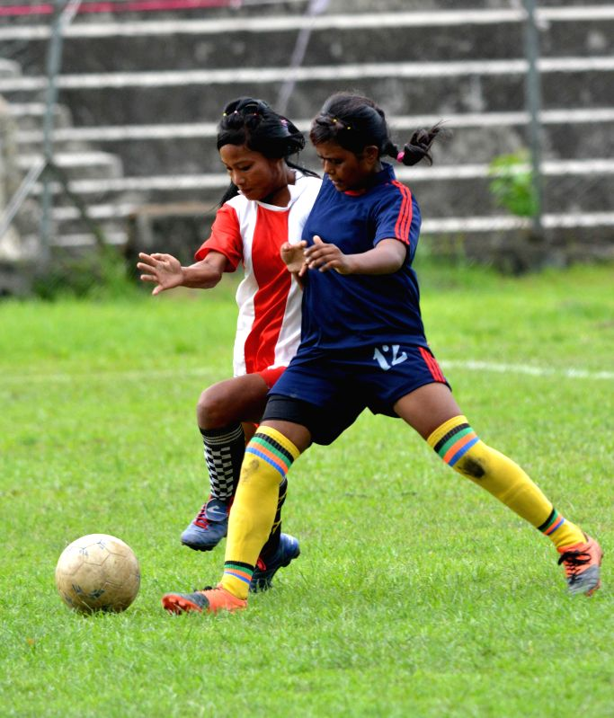 Players of Kiyang Khasia Memorial Tribal High School, Hailakandi (red & white jersey) enjoys a goal against Dakhin Mazbat High School, Udulguri during under 17 2nd Inter-District School Girls ...
