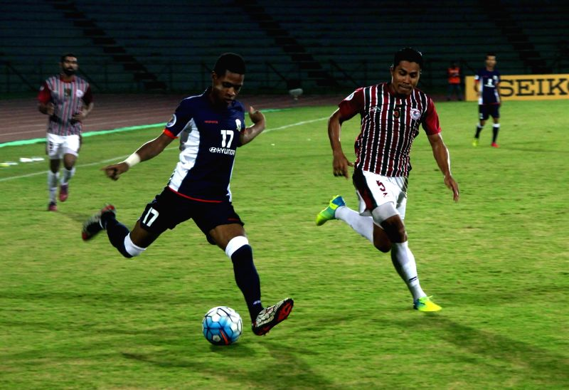 Players of Mohun Bagan A.C. and Tampines Rovers FC of Singapore in action during an AFC Cup match in Guwahati on May 24, 2016.