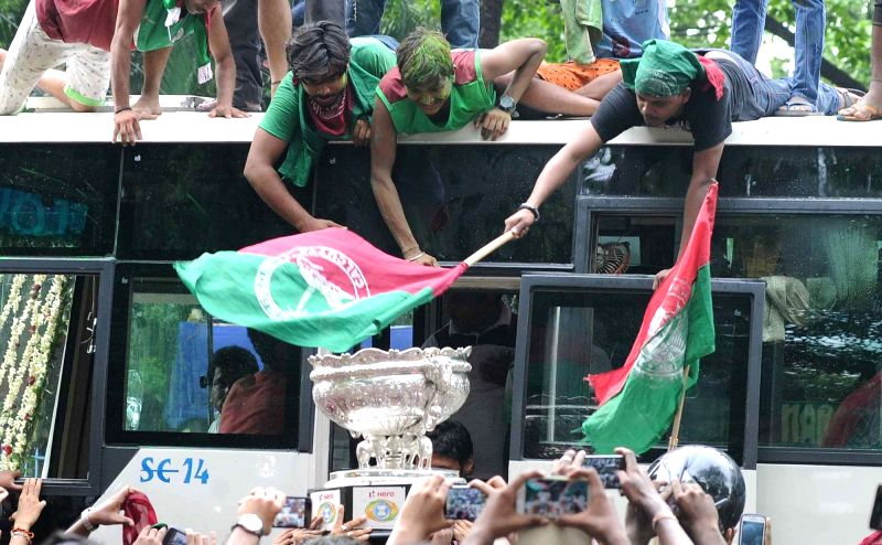Players of Mohun Bagan A.C and their fans celebrate after winning the 14th Federation Cup in Kolkata, on May 25, 2016.