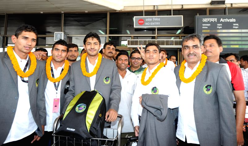 Players of Patna Pirates - kabbadi team arrive at Patna Airport on Aug 5, 2014.