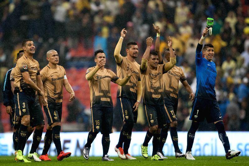 Players of Pumas de la UNAM celebrate victory after the Semi-Finals of the Opening Tournament of the MX League against Pumas de la UNAM, at Azteca Stadium in ...