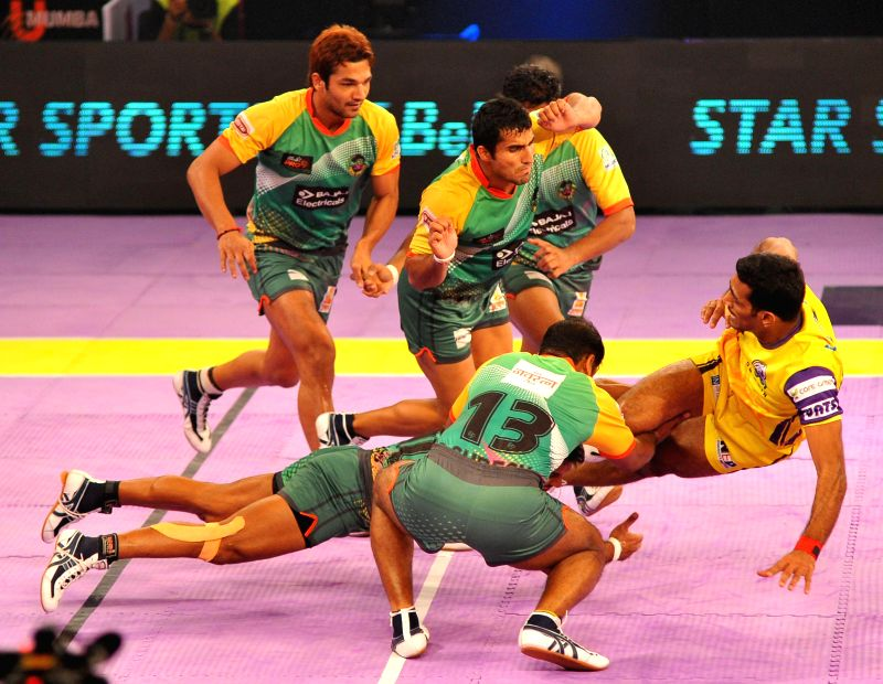 Players of  Teluge Titans and Patna Pirates in action during the Pro Kabaddi league match at Sawai Mansingh Indoor Stadium in Jaipur on Aug. 23, 2014.
