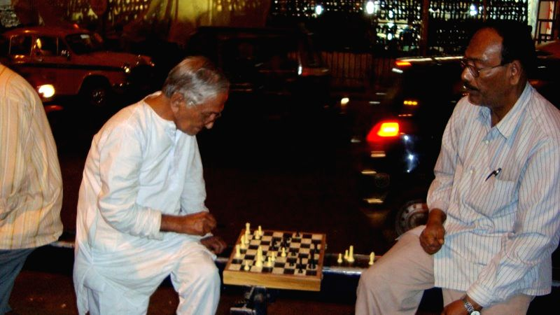 Playing chess under a flyover in Kolkata.