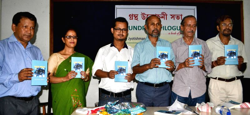 Poet Samir Tati and other dignitaries during launch of Jyotishman Debnath's poetry book `Hundred Epilogues` at Guwahati press club on July 27, 2014.