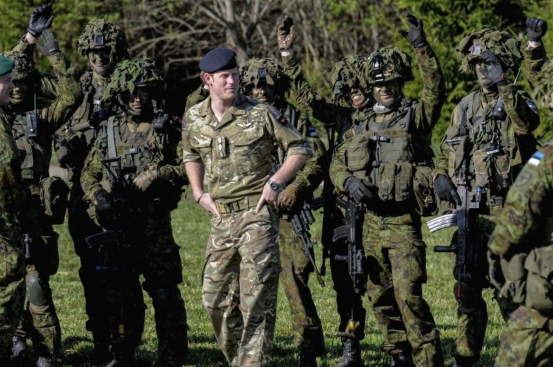 Britain's Prince Harry(C) meets Estonia soldiers on May 17, 2014 during a visit to the Estonian Defence Forces annual pring Stormtraining exercises held near ...