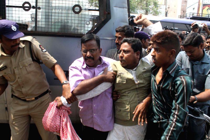 Police arrests Darsgah-e-Jihad-o-Shahadat (DJS) activists demonstrating against 2007 Mecca Masjid bombing in Hyderabad on May 18, 2014.