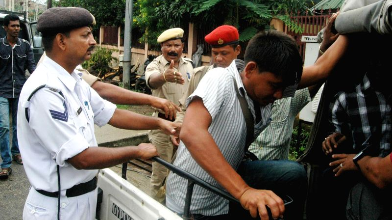 Police arrests members of All Assam Contractual M.P.W (M) Employees Union demonstrating near Assam Chief Minister Tarun Gogol's residence  to press for their various demands at Prasanti Udayan in .. - Tarun Gogol