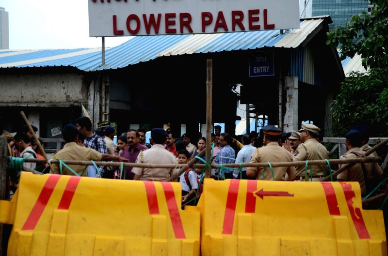 Police barricades put up to prevent the movement of commuters at the Lower Parel rail overbridge where repair work is underway, in Mumbai on July 24, 2018.
