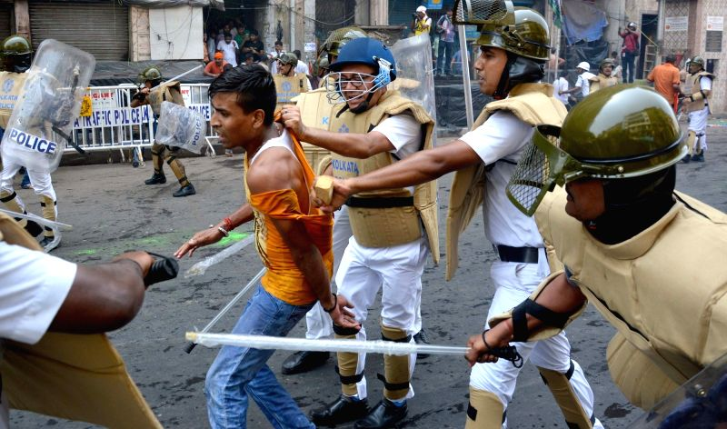 Police charge batons on BJP workers protesting against the law and order situation in West Bengal and fake cases lodged against their party workers among other issues in Lalbazar of Kolkata ...