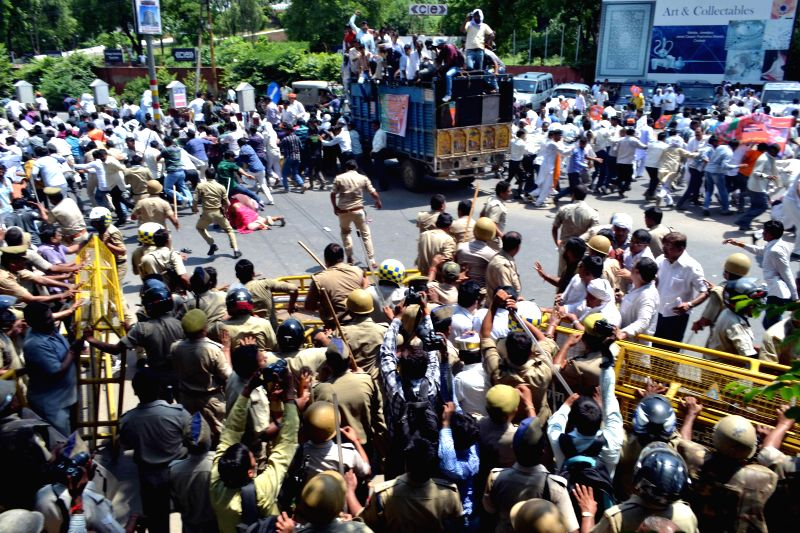 Police charge batons on people protesting against power cuts in Agra on Aug 27, 2014.