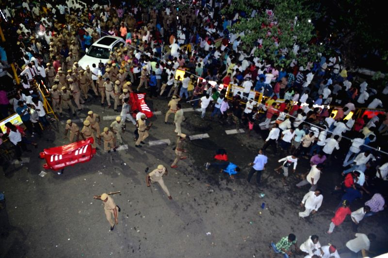 Police charge batons on people who gathered outside Kauvery Hospital where DMK President M. Karunanidhi is admitted in Chennai on July 29, 2018.