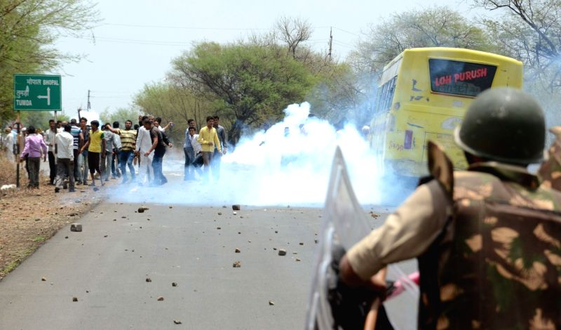 Police charge tear gas to disperse protesting farmers in Bhopal on June 9, 2017.