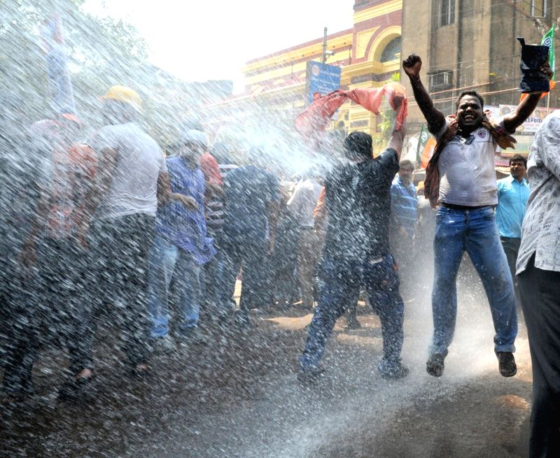 Police charge water cannons on BJP workers protesting against the law and order situation in West Bengal and fake cases lodged against their party workers among other issues in Lalbazar of ...