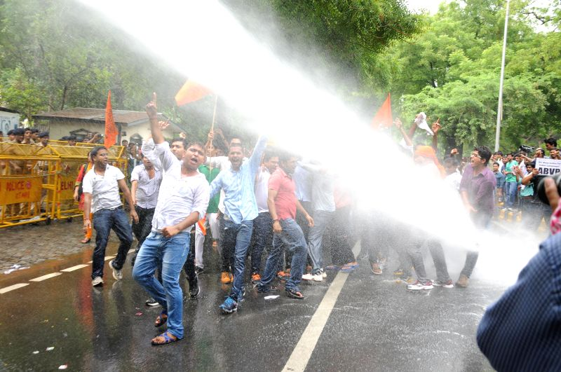 Police charges water cannons on ABVP activists demonstrating outside UPSC office in New Delhi on July 14, 2014.