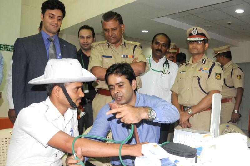 Police Commissioner of Bangalore M N Reddy at a free health check-up camp set-up by a private hospital in Bangalore on August 1, 2014. - M N Reddy