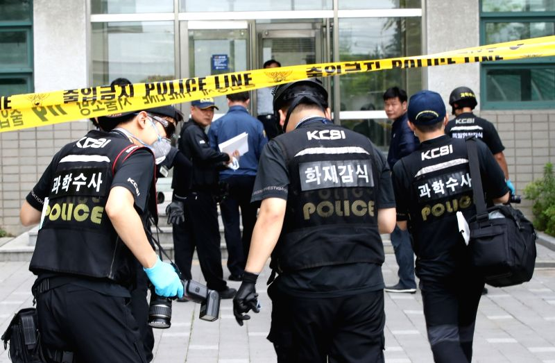 Police investigators enter a building at Yonsei University campus in Seoul on June 13, 2017, after what appears to be a nail bomb explosion. A professor was hurt from the blast traced to a delivered ...