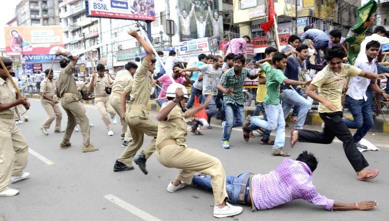 Police lathicharge on Patna University students demanding hostel facility at the Dak Bangla area in Patna on July 24, 2014.