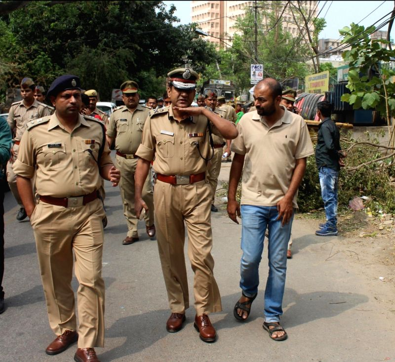 Police officials investigate the Anurag Tiwari death case in Lucknow on May 17, 2017. Tiwari was found dead under mysterious circumstances.