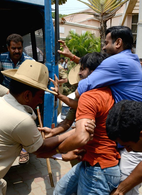Police personnel arrest students protesting against hike in examination fees of Bangalore University at Central College in Bangalore on April 25, 2014.