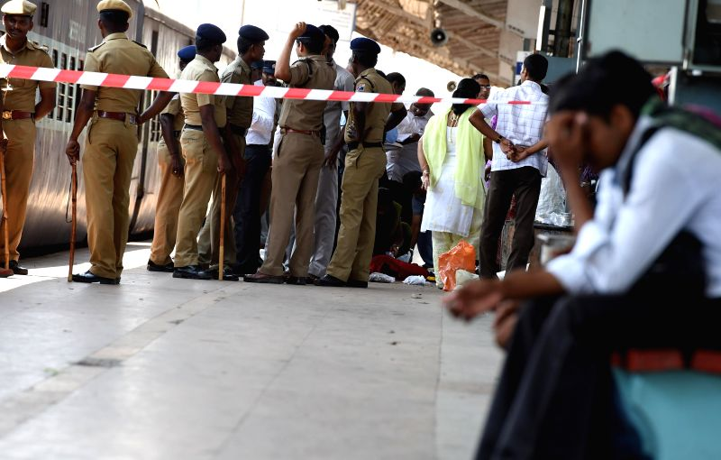 Police personnel at the platform where two bomb blasts took place in two coaches of the Guwahati-Bangalore train, minutes after it entered the Chennai railway station on May 1, 2014. A young woman ...