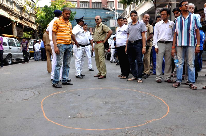 Police personnel at the spot where crude bombs were found in Posta area of Kolkata's Burrabazar during the ninth phase of 2014 Lok Sabha Polls in Kolkata on May 12, 2014.