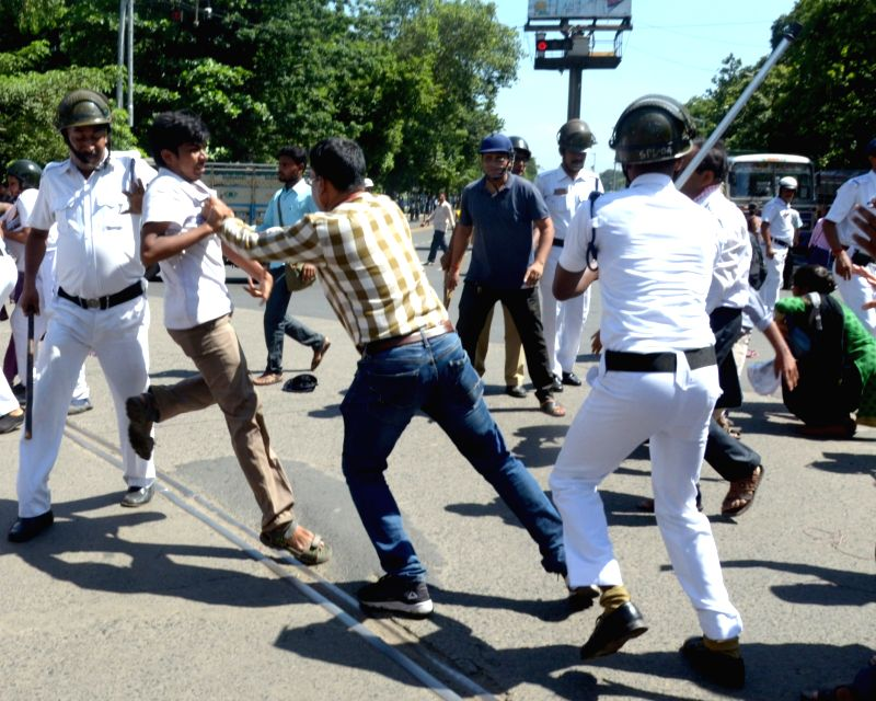 Police personnel beats up Socialist Unity Centre of India (Communist) activists staging a demonstration, in Kolkata, on July 19, 2018.