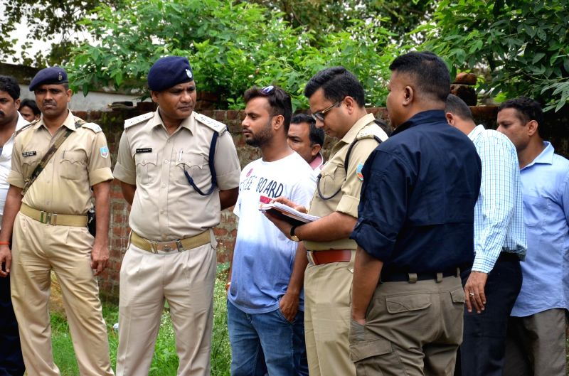 Police personnel carry out investigation at the house where seven members of a family were found dead, in Ranchi on July 30, 2018. According to an officer, the police found bodies of Deepak ... - Deepak Kumar Jha