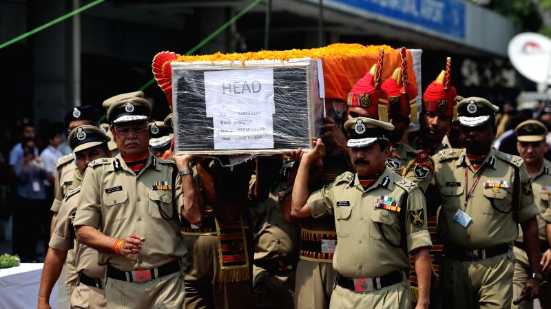 Police personnel carry the coffin of martyred BSF Head Constable Prem Sagar in New Delhi on May 2, 2017.