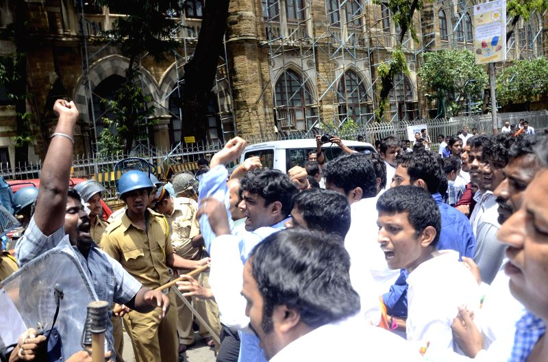 Police personnel charge lathis on Youth Congress activists demonstrating against Shivsena and BJP in Mumbai on Aug 11, 2014.